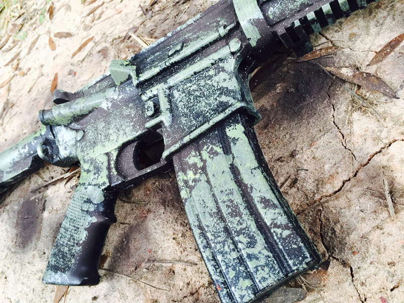 green camo paint on black rifle 2