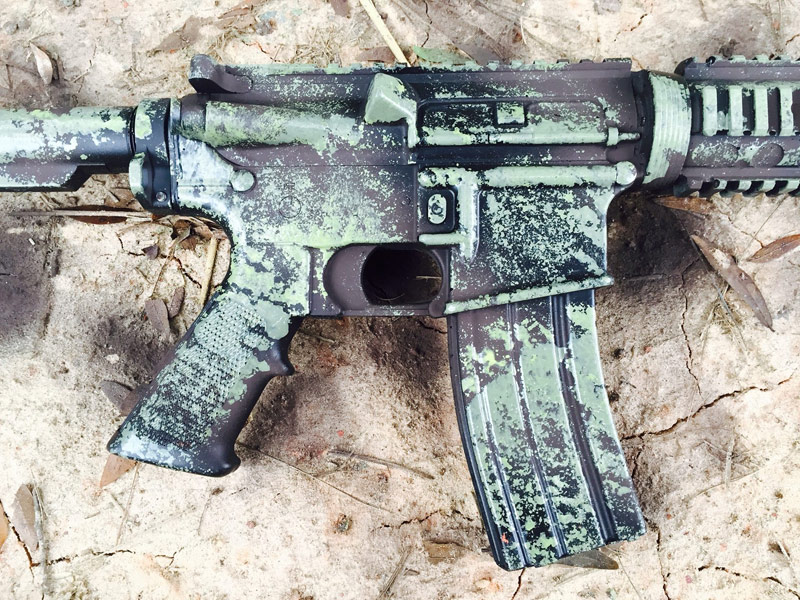 green camo paint on black rifle